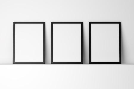 Photo for three blank black photo frames on white shelf - Royalty Free Image
