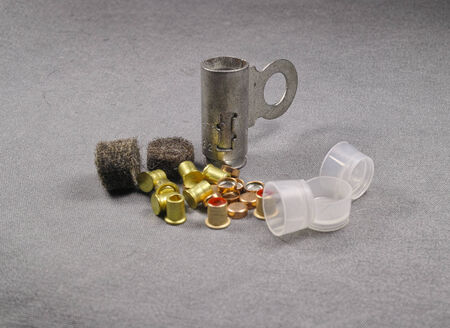set of percussion caps and felt wad for reloading