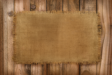 Foto de Rustic background of Burlap material on a wooden table with copy space  - Imagen libre de derechos