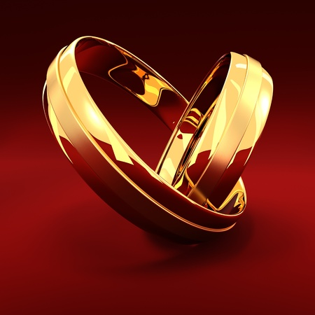 Photo pour Two golden wedding rings on the red background - image libre de droit