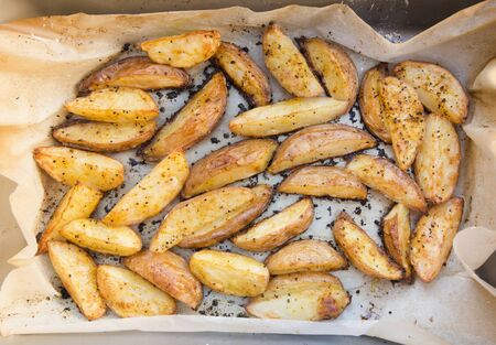 Oven baked potato wedges home made wrapped in baking paper