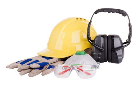 Foto de Safety equipment or PPE - personal protective equipment - with hard hat, safety glasses, gloves, face mask and earmuffs isolated on white - Imagen libre de derechos