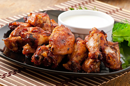Photo for Baked chicken wings in the Asian style - Royalty Free Image