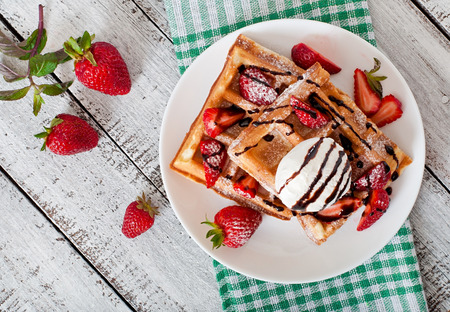 Photo for Belgium waffles with strawberries and ice cream on white plate - Royalty Free Image