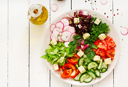 Photo pour Mix salad from fresh vegetables and greens herbs. Dietary menu. Proper nutrition. Healthy lifestyle. Flat lay. Top view - image libre de droit
