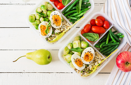 Photo pour Vegetarian meal prep containers with eggs, brussel sprouts, green beans and tomato. Dinner in lunch box. Top view. Flat lay - image libre de droit