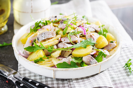 Photo for Traditional  salad of salted herring fillet, fresh apples,  red onion  and potatoes. Kosher food. Scandinavian cuisine. - Royalty Free Image