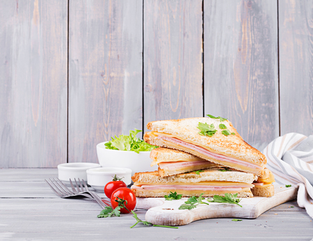 Photo for Club sandwich panini with ham, cheese and salad. Tasty breakfast - Royalty Free Image