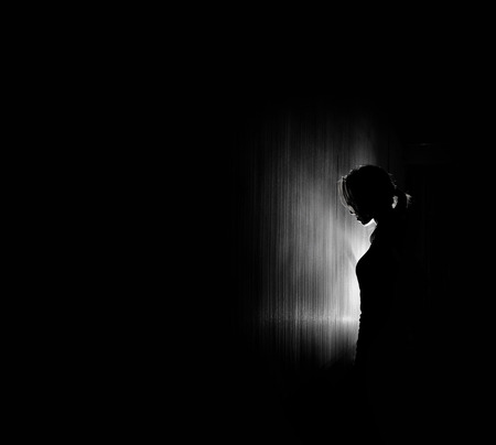 Foto de beautiful woman silhouette, black background. - Imagen libre de derechos
