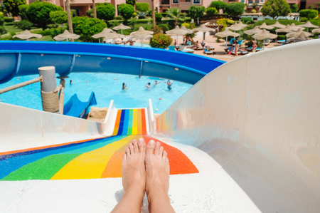 Photo for beautiful young woman pulls off the slides in the water park - Royalty Free Image