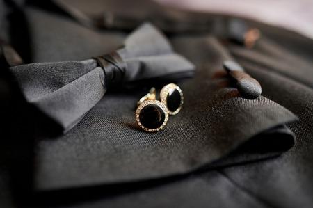 Photo pour Accessories butterfly and cufflinks for a classic suit. - image libre de droit
