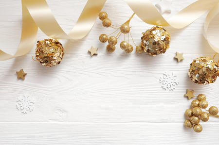 Photo for Mockup Christmas decor top view and gold ball, flatlay on a white wooden background with a ribbon, with place for your text - Royalty Free Image