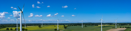 Photo for Panoramic aerial view and closeup of a wind turbine in a wind farm with rape field - Royalty Free Image