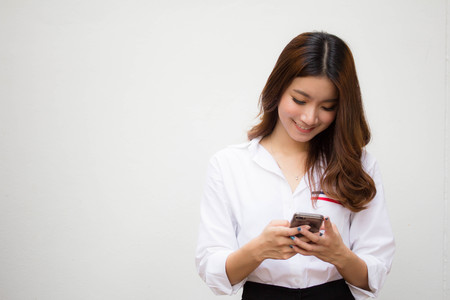 Photo for Portrait of thai adult working women white shirt using smart phone - Royalty Free Image