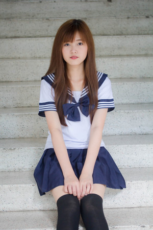 Photo pour Portrait of thai teen beautiful girl in japanese student uniform happy and relax - image libre de droit