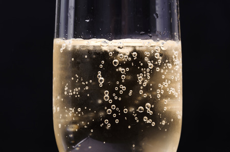Photo for Close up Champagne bubble in glass on black background - Royalty Free Image