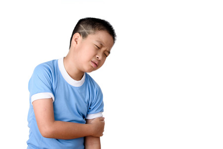 Photo pour Young asian Thai boy has pain at his arm, isolated on white background. - image libre de droit