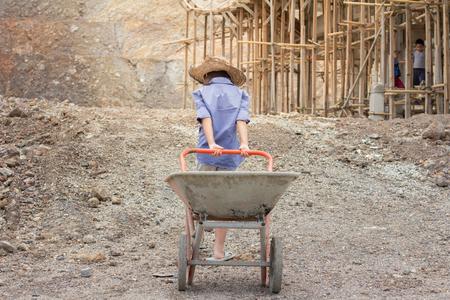Photo pour Poor children working at construction site against children labour,  World Day Against Child Labour  and trafficking concept. - image libre de droit
