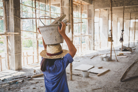 Photo for Poor children are forced to work construction, Violence children and trafficking concept,Anti-child labor, Rights Day on December 10. - Royalty Free Image