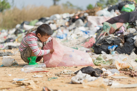 Photo pour Poor children collect garbage for sale because of poverty, Junk recycle, Child labor, Poverty concept, World Environment Day, - image libre de droit