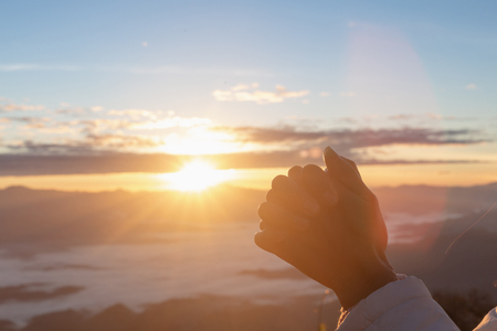 Photo for Christian woman  hands praying to god on the mountain background with morning sunrise. Woman Pray for god blessing to wishing have a better life. Christian life crisis prayer to god. - Royalty Free Image