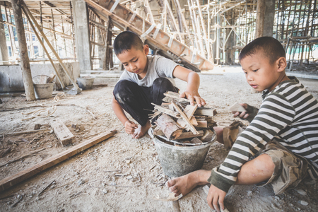 Photo for boys labor work in the construction site,  Against child labor, Poor children,  construction work, Violence children and trafficking concept - Royalty Free Image