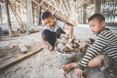 Photo pour boys labor work in the construction site,  Against child labor, Poor children,  construction work, Violence children and trafficking concept - image libre de droit