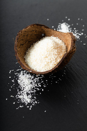 Photo for Food organic dried desiccated coconut in the coconut shell with copy space - Royalty Free Image