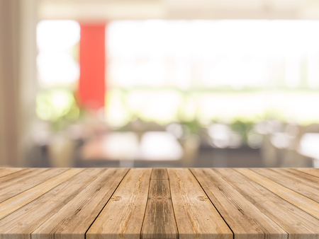 Photo pour Wooden board empty table in front of blurred background. Perspective brown wood over blur in coffee shop - can be used for display or montage your products.Mock up your products.Vintage filter. - image libre de droit
