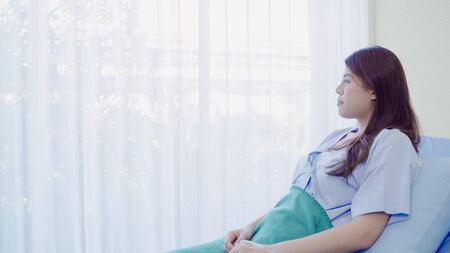 Foto per Beautiful Asian patient sick and sleeping while staying on Patient's bed at hospital. Medicine and health care concept. - Immagine Royalty Free