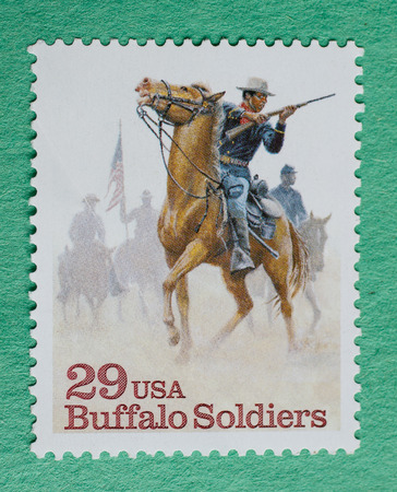 Foto de US Christmas postage stamp with an illustration of Buffalo Soldiers. - Imagen libre de derechos