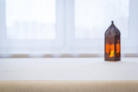 Foto de Orange lamp on the table against the defocused window - Imagen libre de derechos