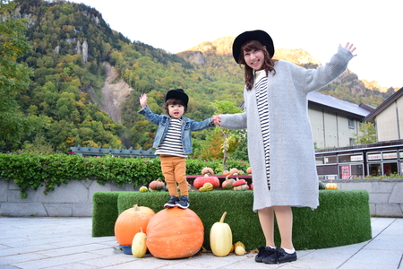 halloween mother and son with colorful pumpkin