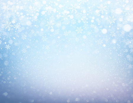 Foto de Snowflakes and snowfall on a frozen blue background - Winter material - Imagen libre de derechos