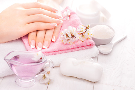 Photo for french manicure with essential oils, apricot flowers. spa - Royalty Free Image