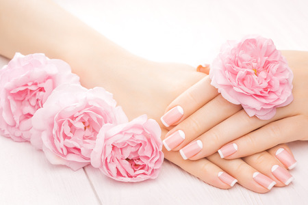 Photo pour french manicure with rose flowers. spa - image libre de droit