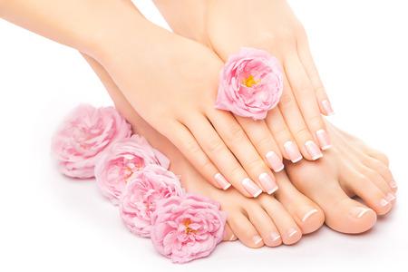 Photo pour pedicure and manicure with a pink rose flower - image libre de droit