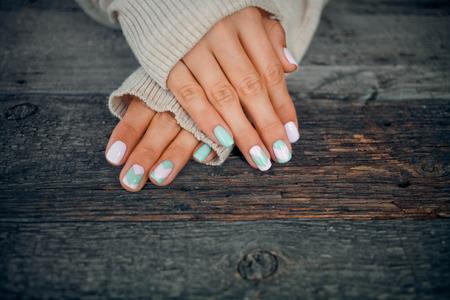 Photo pour Female hands with gentle nail design. - image libre de droit