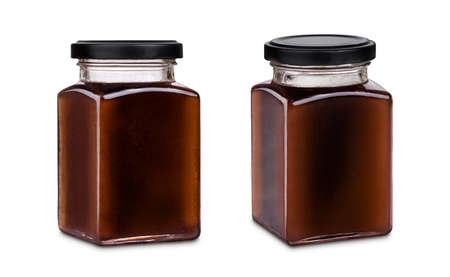 Photo pour Square jar of dark honey with black cap isolated on white background, various phases and views - image libre de droit