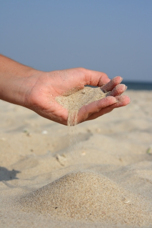 Scattered sand against the sea