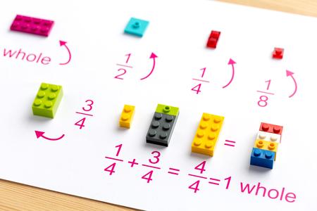 Foto de The child puts the colored blocks in the right place. Math games for children. Mathematics, logic, training - Imagen libre de derechos
