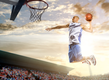 Photo pour Basketball player in action on background of sky and crowd - image libre de droit