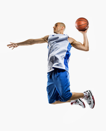 Photo pour Basketball player isolated on white - image libre de droit