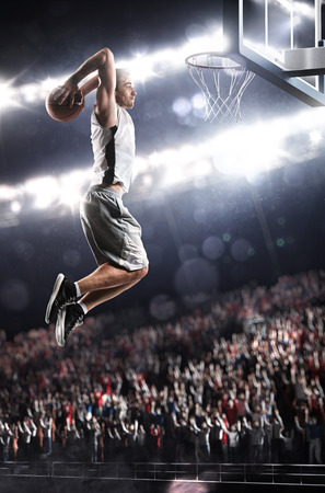 Photo pour Basketball player in action flying high and scoring - image libre de droit