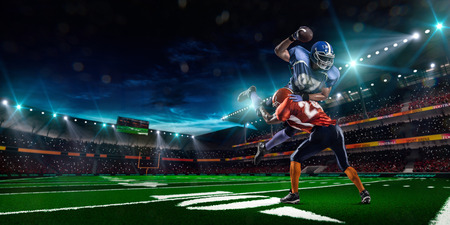 Photo pour American football player in action on the stadium - image libre de droit