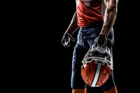 Photo pour American football sportsman player is isolated on the  black - image libre de droit