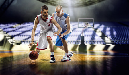Photo pour Two basketball players action in the city gym - image libre de droit