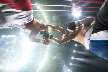Foto de Two professionl boxers are fighting on the grand arena - Imagen libre de derechos