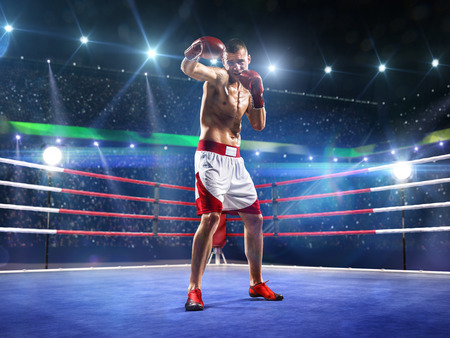 Professionl boxer is standing on the grand arena