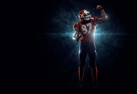 Photo pour Proud american football player  i dark - image libre de droit
